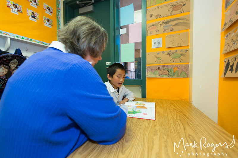 Students, Teachers and Experience Corps Volunteers photographed during class at Moscone Elementary School in San Francisco, California