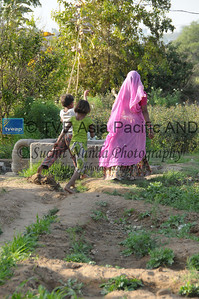 Mobile phone use in Rural Rajasthan (Village near Pushkar): Family members of Sayar Singh at Chamunda Matha Road, Pushkar, Rajasthan, India.