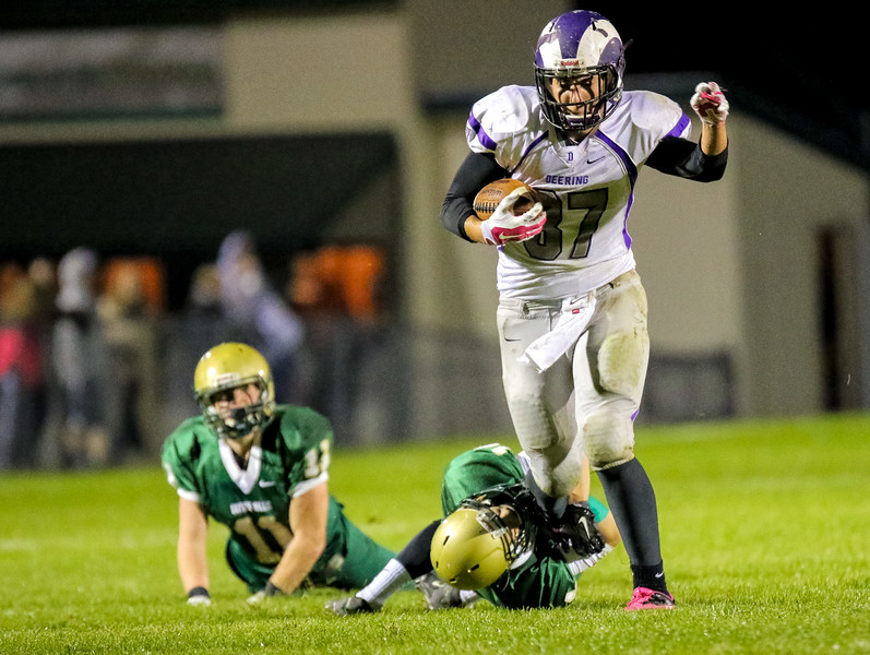 Oxford Hills' Brayden Bean attempts to bring down Deering's Dominick Bernard after Bernard's reception from quarterback Max Chabot.