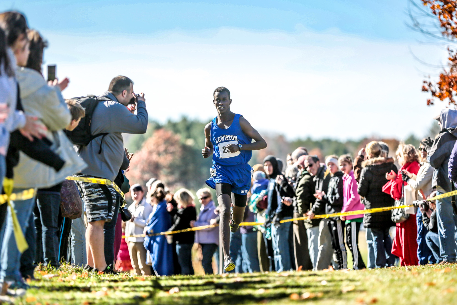 "Floating: Lewiston's Osman Doorow cruises on the lead just after the two-mile point of yesterday's state championship cross country meet. Doorow won, ending the year undefeated.  All photos:  <a href=""http://www.brewstersphotos.com"">http://www.brewstersphotos.com</a>"