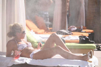 Lounging in Misted Cabanas