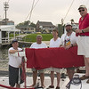 "Tom Sutton, Shelton Alsup, Paul Eley, Bert Meadows, Jim Davis (Boat they are aboard is called ""Leading Edge"")"