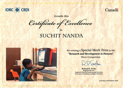 "Certificate of Merti award to my photo that won a merit award from IDRC:  ""The Promise of Tomorrow"" - Kothmale Radio Station is located in Sri Lanka a country which has become split between the Sinhalese and Tamil ethnic groups. Although a Sinhalese area, couple of Tamilian children come to the Kothmale Radio station to learn computers. Despite language barriers, the teachers are able to guide and help these children with a promise for a better tomorrow.   Kothmale Community Radio, Sri Lanka http://www.kothmale.org/ (Part of R&D Grant of IDRC's PAN Asia Networking) http://www.idrc.ca/panasia/ev-81912-201-1-DO_TOPIC.html"