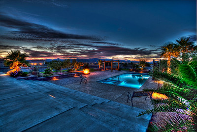 HDR Shot of the backyard at night.  Once you get past the slightly exaggerated colors and contrast due to the HDR processing, it's a true representation of the backyard at night.