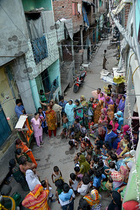 Community awareness meeting being conducted by Mobile Creches in the streets at Seemapuri, Delhi.  Mobile Creches works with birth to 12 year old children living on the construction sites and slums of Delhi(NCR) since 1969. Integrated Daycare Centers for children on construction sites are run. Mobile Creches has so far reached out to 7,50,000 children, trained 6,500 women as childcare workers, run 650 daycare centres and partnered with 200 builders.  Mobile Creches runs daycares centres where children are provided education, nutrition and healthcare. Community-women and NGOs are trained to provide care and speak-up for the child. The years of experience along with strong-networks helps in the advocacy for policy-change.