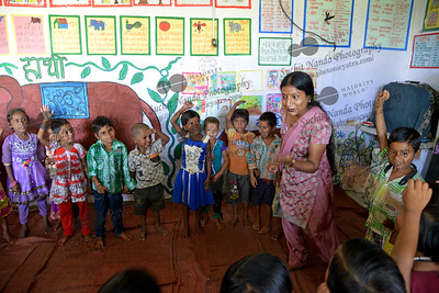 Kamini, the staff teacher playing rail-gadi (train) with the children at the Mobile Creches, Vatika-83, Gurgaon, Delhi, NCR.  Mobile Creches works with birth to 12 year old children living on the construction sites and slums of Delhi(NCR) since 1969. Integrated Daycare Centers for children on construction sites are run. Mobile Creches has so far reached out to 7,50,000 children, trained 6,500 women as childcare workers, run 650 daycare centres and partnered with 200 builders.  Mobile Creches runs daycares centres where children are provided education, nutrition and healthcare. Community-women and NGOs are trained to provide care and speak-up for the child. The years of experience along with strong-networks helps in the advocacy for policy-change.