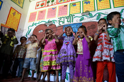 Children play at the Mobile Creches, Vatika-83, Gurgaon, Delhi, NCR.  Mobile Creches works with birth to 12 year old children living on the construction sites and slums of Delhi(NCR) since 1969. Integrated Daycare Centers for children on construction sites are run. Mobile Creches has so far reached out to 7,50,000 children, trained 6,500 women as childcare workers, run 650 daycare centres and partnered with 200 builders.  Mobile Creches runs daycares centres where children are provided education, nutrition and healthcare. Community-women and NGOs are trained to provide care and speak-up for the child. The years of experience along with strong-networks helps in the advocacy for policy-change.