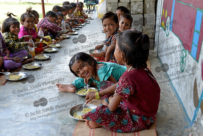 Riya (right), Payal and other children having a healthy meal at Mobile Creches, Vatika-83, Gurgaon, Delhi, NCR.  Mobile Creches works with birth to 12 year old children living on the construction sites and slums of Delhi(NCR) since 1969. Integrated Daycare Centers for children on construction sites are run. Mobile Creches has so far reached out to 7,50,000 children, trained 6,500 women as childcare workers, run 650 daycare centres and partnered with 200 builders.  Mobile Creches runs daycares centres where children are provided education, nutrition and healthcare. Community-women and NGOs are trained to provide care and speak-up for the child. The years of experience along with strong-networks helps in the advocacy for policy-change.