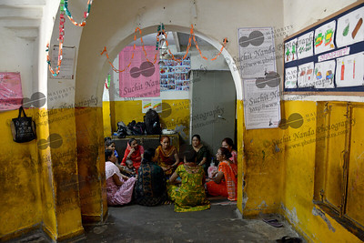 Staff meeting at the Mobile Creches, Seemapuri Centre.  Mobile Creches works with birth to 12 year old children living on the construction sites and slums of Delhi(NCR) since 1969. Integrated Daycare Centers for children on construction sites are run. Mobile Creches has so far reached out to 7,50,000 children, trained 6,500 women as childcare workers, run 650 daycare centres and partnered with 200 builders.  Mobile Creches runs daycares centres where children are provided education, nutrition and healthcare. Community-women and NGOs are trained to provide care and speak-up for the child. The years of experience along with strong-networks helps in the advocacy for policy-change.