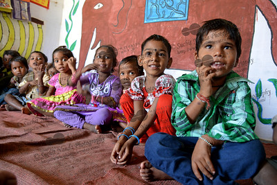 Sumit (right), Chandini and other children at the Mobile Creches, Vatika-83, Gurgaon, Delhi, NCR.  Mobile Creches works with birth to 12 year old children living on the construction sites and slums of Delhi(NCR) since 1969. Integrated Daycare Centers for children on construction sites are run. Mobile Creches has so far reached out to 7,50,000 children, trained 6,500 women as childcare workers, run 650 daycare centres and partnered with 200 builders.  Mobile Creches runs daycares centres where children are provided education, nutrition and healthcare. Community-women and NGOs are trained to provide care and speak-up for the child. The years of experience along with strong-networks helps in the advocacy for policy-change.