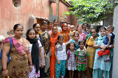 Staff and mothers with their children at the Mobile Creches run Centre in Seemapuri, Delhi.  Mobile Creches works with birth to 12 year old children living on the construction sites and slums of Delhi(NCR) since 1969. Integrated Daycare Centers for children on construction sites are run. Mobile Creches has so far reached out to 7,50,000 children, trained 6,500 women as childcare workers, run 650 daycare centres and partnered with 200 builders.  Mobile Creches runs daycares centres where children are provided education, nutrition and healthcare. Community-women and NGOs are trained to provide care and speak-up for the child. The years of experience along with strong-networks helps in the advocacy for policy-change.