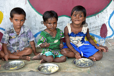 Anshu, Poorti, and Nishu having a mid-day meal at Mobile Creches, Vatika-83, Gurgaon, Delhi, NCR.  Mobile Creches works with birth to 12 year old children living on the construction sites and slums of Delhi(NCR) since 1969. Integrated Daycare Centers for children on construction sites are run. Mobile Creches has so far reached out to 7,50,000 children, trained 6,500 women as childcare workers, run 650 daycare centres and partnered with 200 builders.  Mobile Creches runs daycares centres where children are provided education, nutrition and healthcare. Community-women and NGOs are trained to provide care and speak-up for the child. The years of experience along with strong-networks helps in the advocacy for policy-change.