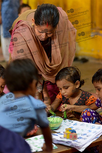 Children being taught to paint at the Mobile Creches, Seemapuri Centre.  Mobile Creches works with birth to 12 year old children living on the construction sites and slums of Delhi(NCR) since 1969. Integrated Daycare Centers for children on construction sites are run. Mobile Creches has so far reached out to 7,50,000 children, trained 6,500 women as childcare workers, run 650 daycare centres and partnered with 200 builders.  Mobile Creches runs daycares centres where children are provided education, nutrition and healthcare. Community-women and NGOs are trained to provide care and speak-up for the child. The years of experience along with strong-networks helps in the advocacy for policy-change.