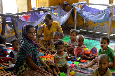 Children playing with different toys at the Mobile Creches, Seemapuri Centre.  Mobile Creches works with birth to 12 year old children living on the construction sites and slums of Delhi(NCR) since 1969. Integrated Daycare Centers for children on construction sites are run. Mobile Creches has so far reached out to 7,50,000 children, trained 6,500 women as childcare workers, run 650 daycare centres and partnered with 200 builders.  Mobile Creches runs daycares centres where children are provided education, nutrition and healthcare. Community-women and NGOs are trained to provide care and speak-up for the child. The years of experience along with strong-networks helps in the advocacy for policy-change.