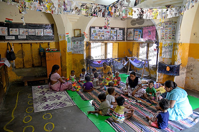 Young children playing at the Mobile Creches, Seemapuri Centre.  Mobile Creches works with birth to 12 year old children living on the construction sites and slums of Delhi(NCR) since 1969. Integrated Daycare Centers for children on construction sites are run. Mobile Creches has so far reached out to 7,50,000 children, trained 6,500 women as childcare workers, run 650 daycare centres and partnered with 200 builders.  Mobile Creches runs daycares centres where children are provided education, nutrition and healthcare. Community-women and NGOs are trained to provide care and speak-up for the child. The years of experience along with strong-networks helps in the advocacy for policy-change.