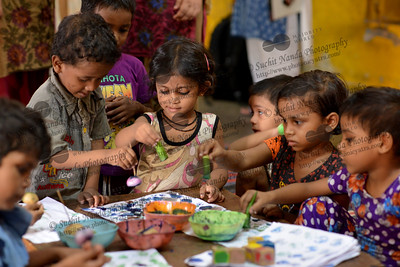 Children painting at the Mobile Creches, Seemapuri Centre.  Mobile Creches works with birth to 12 year old children living on the construction sites and slums of Delhi(NCR) since 1969. Integrated Daycare Centers for children on construction sites are run. Mobile Creches has so far reached out to 7,50,000 children, trained 6,500 women as childcare workers, run 650 daycare centres and partnered with 200 builders.  Mobile Creches runs daycares centres where children are provided education, nutrition and healthcare. Community-women and NGOs are trained to provide care and speak-up for the child. The years of experience along with strong-networks helps in the advocacy for policy-change.
