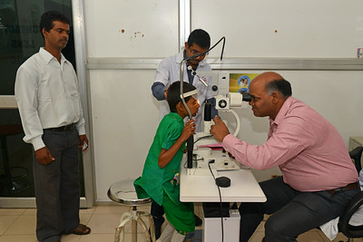 Payal has cataract in both her eyes. She went from doctor to doctor until finally she was correctly diagnosed and treated at the Nav Bharat Jagriti Kendra (NBJK) Lok Nayak Jai Prakash Eye Hospital. Doctors examine her eyes to see the progress while her anxious father waits to hear the results.  Nav Bharat Jagriti Kendra (NBJK) was established in 1971 by four engineering graduates who  were sensitive to the causes of disparity, exploitation and poverty with an aim to  establish a just society. Today they are the leading non-profit organization in Jharkhand  running educational institution and health facilities.