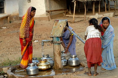 India: Women in a village near Nagpur, Maharashtra, India, come to the locall hand pumped well to collect water for their homes.