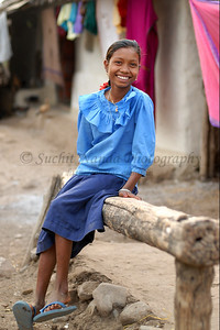 India: Sweet smile of the child melts the heart. Living in rather poor and difficult conditions, the inner happiness shows through. Sitting outside her house in her village near Nagpur, Maharashtra, she was happy to be photographed. Jan 2007.
