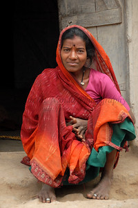 India: This portrait was shot of the lady sitting outside her home in her colourful saree. Jan 2007.