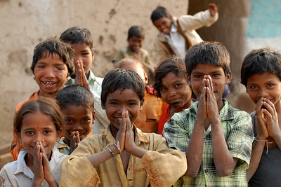 "India: Children in a village near Nagpur, Maharashtra, India doing ""Namaste"" which is a form of welcome or greeting. Jan 2007."
