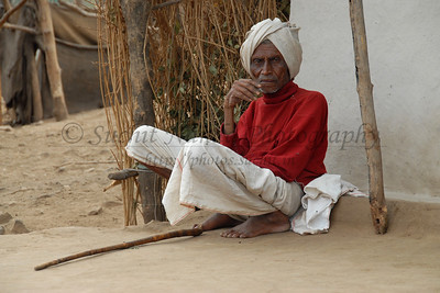"India: ""Old man with his stick"": This old man was sitting at the corner with his stick and watching everyone passing by. Image taken in a village near Nagpur, Maharashtra. Jan 2007."