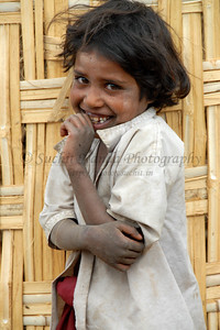 "India: ""Shy"": This little girl was shy and coy at the same time. Image shot in a village near Nagpur, Maharashtra. Jan 2007."