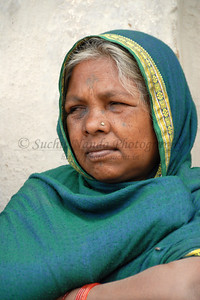 India: This is a portrait of a lady was quick vocal and expressive about their role and difficulties they face. She was attending a meeting organized by SIRDI which is an NGO working with rural women in Maharashtra & MP state. In their conversation, they told me that even a few years back let alone talk or being photographed they would not even come near a man but today with the working of the NGOs in the village they have a better understanding and knowledge so they share their problems and want to be assertive about their role.    India: Women in a village near Nagpur, Maharashtra, India, produce cloth from cotton & threads also produced by the women's self help group organized by the NGO called SIRDI. 07-Mar-07.