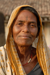 India: Portrait of a lady who was watching the arrival of her grand daughter. Jan 2007.