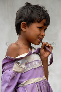 India: This little girl is listening to the women talking at the meeting organized in the local village. The torn cloths and the running nose was not an isolated case. Jan 2007.