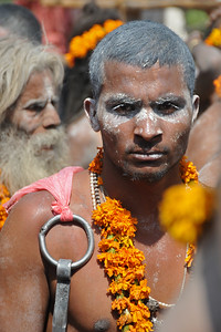 Naga sadhus head to Har Ki Pauri for the holy dip. Pilgrims line on either side of the road for seeking blessings and para military forces provide security cover.  Kumbh Mela is the biggest religious gatherings on the planet which takes places on the banks of the river Ganga. The number of pilgrims this year is expected to exceed around five million since the first day Jan 14 till the time it concludes on April 28, 2010. Haridwar, Uttarakhand. North India.