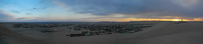 Panoramic Gobi with the setting Sun in the background.