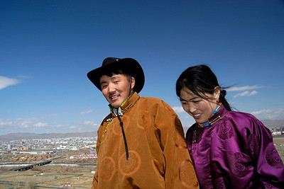 Mongolian couple walking to Zaisan Memorial which is located to the south side of Ulaanbaatar on Zaisan Hill, UB, Mongolia
