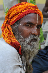 Various holy men come to Haridware for the Kumbh Mela.  Kumbh Mela is the biggest religious gatherings on the planet which takes places on the banks of the river Ganga. The number of pilgrims this year is expected to exceed around five million since the first day Jan 14 till the time it concludes on April 28, 2010. The auspicious days of the shahi snan or royal baths usually draw hundreds of thousands of devotees to the Har Ki Paudi and other banks of the river. Uttarakhand. North India. The occasion draws pilgrims from around the world and severly overloads the infrastructure so most of the city is shut down for any vehicles other than security or emergency services so a sea of humanity walks through the city to get to the bathing ghats.