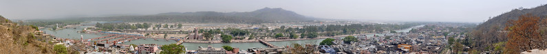 Panoramic view of Haridwar in Apr'10 on the occasion of Kumb Mela.<br /> <br /> Kumbh Mela is the biggest religious gatherings on the planet which takes places on the banks of the river Ganga. The number of pilgrims this year is expected to exceed around five million since the first day Jan 14 till the time it concludes on April 28, 2010. The auspicious days of the shahi snan or royal baths usually draw hundreds of thousands of devotees to the Har Ki Paudi and other banks of the river. Uttarakhand. North India. The occasion draws pilgrims from around the world and severly overloads the infrastructure so most of the city is shut down for any vehicles other than security or emergency services so a sea of humanity walks through the city to get to the bathing ghats.