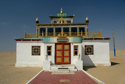 "Buddhist temple and stupa in Gobi desert, Mongolia. Almost as if a non-man land this cluster was an oasis in the desert.  Khamar Monastery was established in the 1820's by famous 19th century Mongolian educator and literary figure Danzanravjaa. The Monastery was an important centre of the Buddhist ""red sect"", and seat of the Gobiin Dogshin Noyon Khutagt (""Terrible Noble Saint of the Gobi"")."