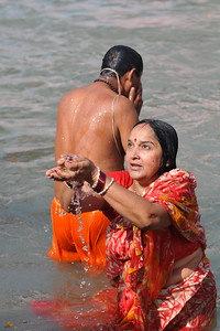 Prayers being offered at the river ghats of the holy Ganga at Har Ki Pauri in Haridwar.  Kumbh Mela is the biggest religious gatherings on the planet which takes places on the banks of the river Ganga. The number of pilgrims this year is expected to exceed around five million since the first day Jan 14 till the time it concludes on April 28, 2010. The auspicious days of the shahi snan or royal baths usually draw hundreds of thousands of devotees to the Har Ki Paudi and other banks of the river. Uttarakhand. North India. The occasion draws pilgrims from around the world and severly overloads the infrastructure so most of the city is shut down for any vehicles other than security or emergency services so a sea of humanity walks through the city to get to the bathing ghats.