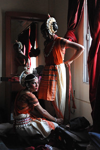 Odissi dancers of  Sutra Dance Academy, Malaysia getting ready for their performance.  The Konark Dance & Music Festival held from February, 19th to 23rd, 2010 was organized by Konark Natya Mandap.  The objectives of the Konark Natya Mandap are to preserve, promote, and project the rich cultural heritage of Orissa and to infuse cultural awareness in the minds of all. Started with painstaking efforts of Guru Gangadhar Pradhan, an internationally renowned Odissi dance teacher. 2010 was the silver jubilee year of the festival. For more details see  http://www.konarknatyamandap.org/    The festival takes place in an open-air auditorium and enlivens the spirit of the sculptures of Konark temple which is just a short distance away. The festival brings in the spirit of merry to all the onlookers. The music reverberates and combined with the sounds of the ankle bells of the dancers enthralls the audiences. The elegant steps and expressions of the dancers makes the event so captivating that no one can ever forget it.