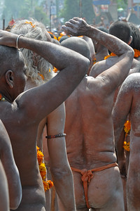Beating drums and on horses and other vehicles arrive the procession of Naga sadhus who as per tradition have the first right of bathing in the holy Ganga on the occasion of Shahi Snan in Kumbh Mela.  Kumbh Mela is the biggest religious gatherings on the planet which takes places on the banks of the river Ganga. The number of pilgrims this year is expected to exceed around five million since the first day Jan 14 till the time it concludes on April 28, 2010. The auspicious days of the shahi snan or royal baths usually draw hundreds of thousands of devotees to the Har Ki Paudi and other banks of the river. Uttarakhand. North India. The occasion draws pilgrims from around the world and severly overloads the infrastructure so most of the city is shut down for any vehicles other than security or emergency services so a sea of humanity walks through the city to get to the bathing ghats.