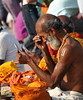 Sadhus adorn themself after taking a bath in the river Ganga at Haridwar.<br /> <br /> Kumbh Mela is the biggest religious gatherings on the planet which takes places on the banks of the river Ganga. The number of pilgrims this year is expected to exceed around five million since the first day Jan 14 till the time it concludes on April 28, 2010. The auspicious days of the shahi snan or royal baths usually draw hundreds of thousands of devotees to the Har Ki Paudi and other banks of the river. Uttarakhand. North India. The occasion draws pilgrims from around the world and severly overloads the infrastructure so most of the city is shut down for any vehicles other than security or emergency services so a sea of humanity walks through the city to get to the bathing ghats.