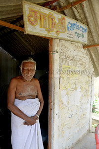 Patient running a barber shop in the village. Rising Star Outreach of India, Kancheepuram District, Tamil Nadu, India