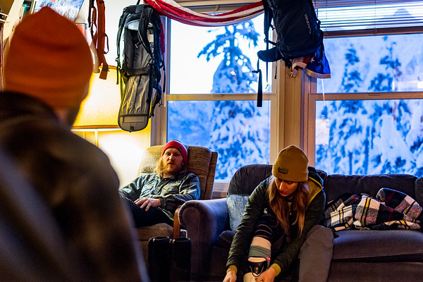 Mt Baker Pro Patrollers Eric Nord, Megan McCarthy and Brandon Helmstetter discussing the days tasks before heading out early to start opening the mountain.