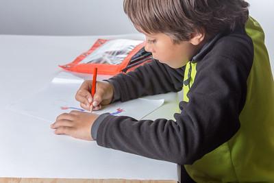 Boy doing school work - homeschool.