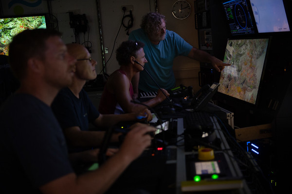 ROV crew and scientists working together to collect samples along the seafloor.