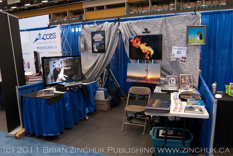 This is my booth at the Estevan Showcase. From left are my bike album, 42 inch plasma TV for slideshows, wedding album beneath it, photobooth entrance, canvas gallery wrap for sale, drilling rig album, photobooth prints, and sundry albums.
