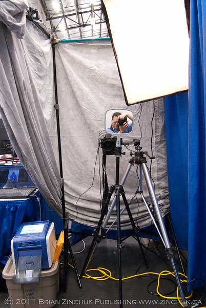 Inside the photobooth - looking at the camera. If you look at the mirro positioned just above the camera, you will find a certain photographer.