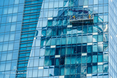 CN Tower reflecting in the Delta Chelsea Hotel with window washers at work, Toronto, Ontario, Canada