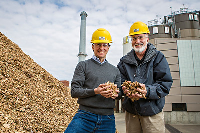 Francisco X. Aguilar, associate professor of forestry, and Hank Stelzer, associate teaching professor and forestry department chair, at the University of Missouri Power Plant on campus. As part of their research, the power plant has coverted a biomass boiler to use grass and wood chips.   Photo by Kyle Spradley | © 2014 - Curators of the University of Missouri