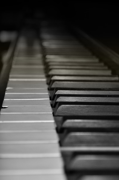 Perpective of Antique Upright Piano Keyboard