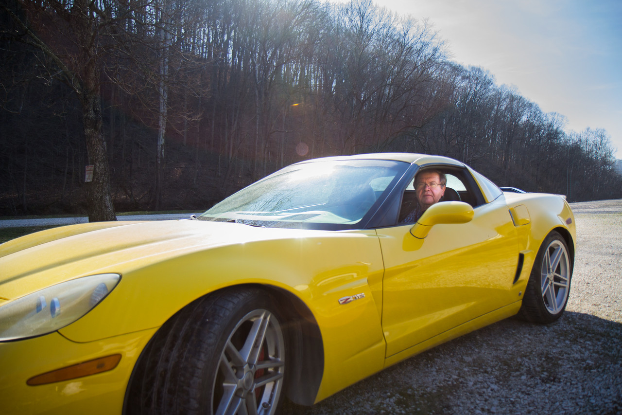 Rich Godlewski poses in his racing Corvette a last time before selling.